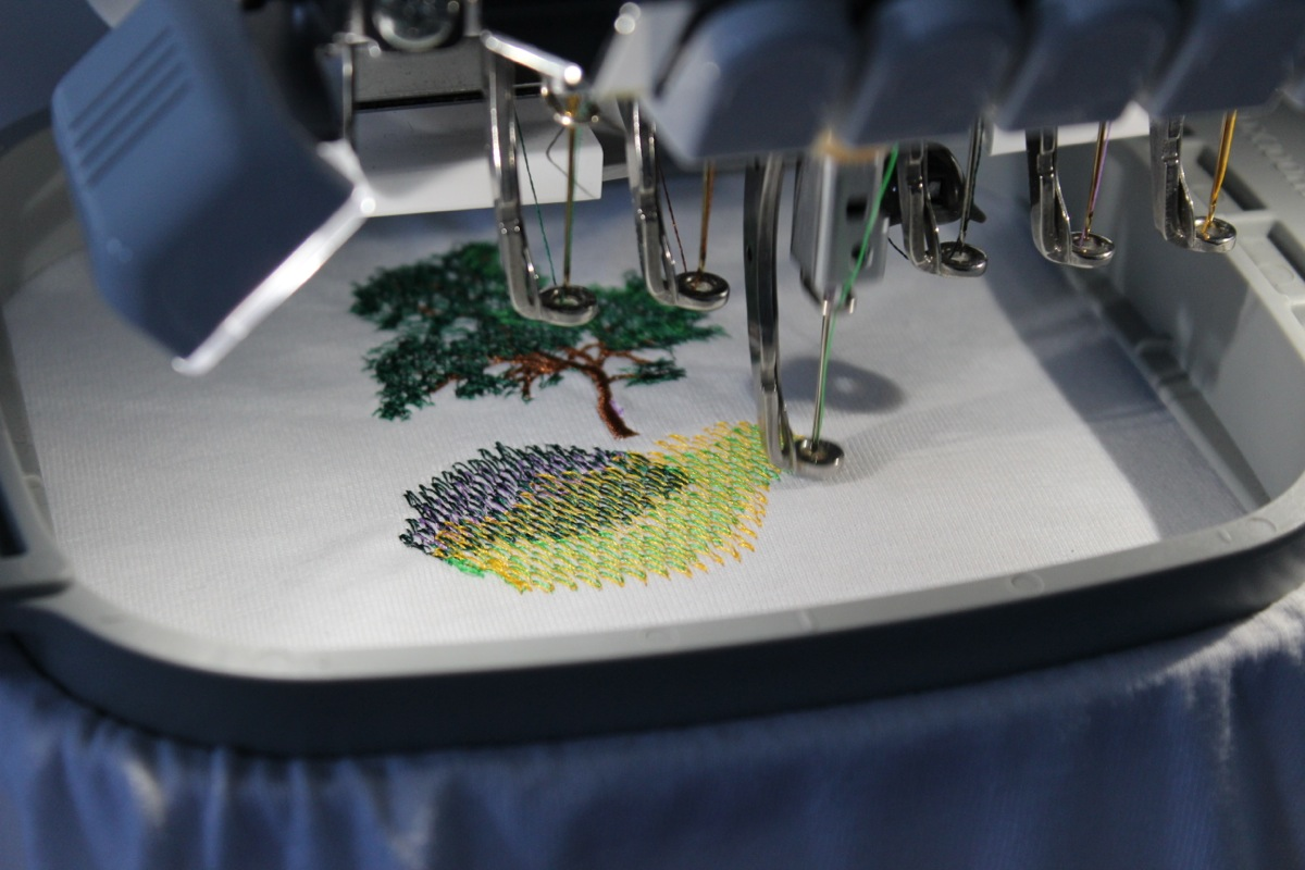 Stitching out the Springtime on Double Peak Event Logo on a T-Shirt